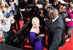 Celebrity emerging from car towards paparazzi Stock Photo - Premium Royalty-Freenull, Code: 635-05550051