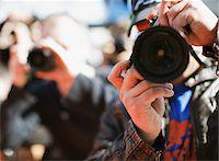 Close up of paparazzo's lens Stock Photo - Premium Royalty-Freenull, Code: 635-05550052