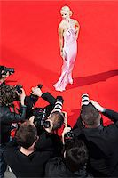 Celebrity posing for paparazzi on red carpet Stock Photo - Premium Royalty-Freenull, Code: 635-05550054