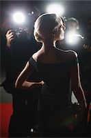 Celebrity posing for paparazzi on red carpet Stock Photo - Premium Royalty-Freenull, Code: 635-05550061