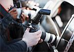 Paparazzi holding camera lens to car window Stock Photo - Premium Royalty-Free, Artist: AWL Images, Code: 635-05550062