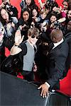 Celebrity emerging from car towards paparazzi Stock Photo - Premium Royalty-Freenull, Code: 635-05550064