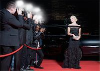 Celebrity posing for paparazzi on red carpet Stock Photo - Premium Royalty-Freenull, Code: 635-05550067