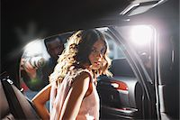 Celebrity emerging from car towards paparazzi Stock Photo - Premium Royalty-Freenull, Code: 635-05550068