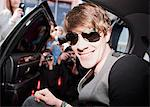 Celebrity emerging from car towards paparazzi Stock Photo - Premium Royalty-Freenull, Code: 635-05550070