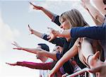 Fans waving from behind barrier Stock Photo - Premium Royalty-Freenull, Code: 635-05550071