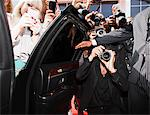 Paparazzi and fans taking photos inside car door Stock Photo - Premium Royalty-Freenull, Code: 635-05550074