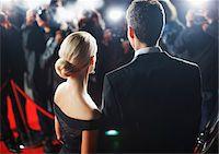 Celebrities posing for paparazzi on red carpet Stock Photo - Premium Royalty-Freenull, Code: 635-05550076