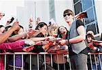 Celebrity signing autographs for fans Stock Photo - Premium Royalty-Freenull, Code: 635-05550077
