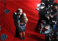 Celebrities posing for paparazzi on red carpet Stock Photo - Premium Royalty-Freenull, Code: 635-05550081