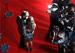 Celebrities posing for paparazzi on red carpet Stock Photo - Premium Royalty-Freenull, Code: 635-05550081