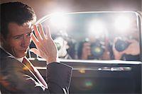 Politician shielding himself from paparazzi Stock Photo - Premium Royalty-Freenull, Code: 635-05550085