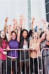 Fans waving from behind barrier Stock Photo - Premium Royalty-Free, Artist: Blend Images, Code: 635-05550093