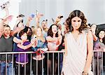 Fans reaching towards celebrity on red carpet Stock Photo - Premium Royalty-Freenull, Code: 635-05550101