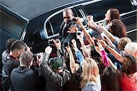 Bodyguard protecting celebrity from paparazzi Stock Photo - Premium Royalty-Freenull, Code: 635-05550107