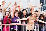 Fans reaching out from behind barrier Stock Photo - Premium Royalty-Freenull, Code: 635-05550111