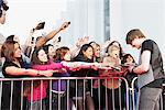 Celebrity signing autographs for fans Stock Photo - Premium Royalty-Free, Artist: Gianni Siragusa, Code: 635-05550119