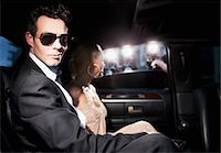 Paparazzi taking pictures of celebrities in limo Stock Photo - Premium Royalty-Freenull, Code: 635-05550120