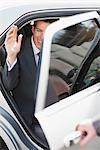 Politician waving and emerging from car Stock Photo - Premium Royalty-Freenull, Code: 635-05550122