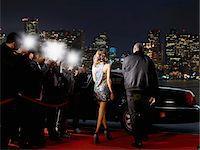 Celebrity walking to car on red carpet Stock Photo - Premium Royalty-Freenull, Code: 635-05550124