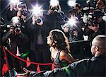 Celebrity emerging from car towards paparazzi Stock Photo - Premium Royalty-Free, Artist: Aurora Photos, Code: 635-05550133