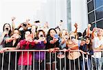 Fans taking pictures with cell phones behind barrier Stock Photo - Premium Royalty-Free, Artist: Blend Images, Code: 635-05550136