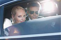 Celebrities sitting in backseat of car Stock Photo - Premium Royalty-Freenull, Code: 635-05550137