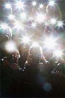 Paparazzi taking pictures with flash Stock Photo - Premium Royalty-Freenull, Code: 635-05550141
