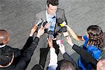Politician talking into reporters' microphones Stock Photo - Premium Royalty-Free, Artist: Westend61, Code: 635-05550145