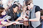 Celebrity signing autographs Stock Photo - Premium Royalty-Freenull, Code: 635-05550147