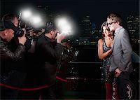 Celebrities posing for paparazzi on red carpet Stock Photo - Premium Royalty-Freenull, Code: 635-05550148
