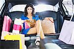 Woman with shopping bags in limo Stock Photo - Premium Royalty-Freenull, Code: 635-05550150