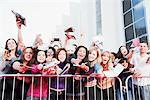 Fans asking for autographs behind barrier Stock Photo - Premium Royalty-Free, Artist: Blend Images, Code: 635-05550155