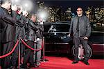 Bodyguard opening limo door on red carpet Stock Photo - Premium Royalty-Freenull, Code: 635-05550167