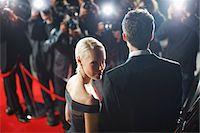 Celebrities posing for paparazzi on red carpet Stock Photo - Premium Royalty-Freenull, Code: 635-05550171
