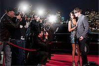 Celebrities posing for paparazzi on red carpet Stock Photo - Premium Royalty-Freenull, Code: 635-05550182
