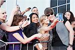 Celebrity taking pictures with fans Stock Photo - Premium Royalty-Freenull, Code: 635-05550194