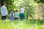 Family walking in field of flowers Stock Photo - Premium Royalty-Freenull, Code: 635-05550204