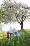 Family walking together under tree in park Stock Photo - Premium Royalty-Freenull, Code: 635-05550210