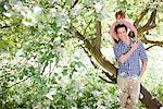 Father playing with son on tree Stock Photo - Premium Royalty-Freenull, Code: 635-05550218