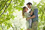 Couple hugging in forest Stock Photo - Premium Royalty-Free, Artist: Blend Images, Code: 635-05550221