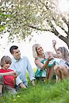 Family relaxing in park Stock Photo - Premium Royalty-Freenull, Code: 635-05550238