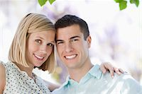 Couple smiling together outdoors Stock Photo - Premium Royalty-Freenull, Code: 635-05550240