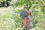 Family standing together in field of flowers Stock Photo - Premium Royalty-Freenull, Code: 635-05550246
