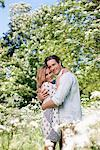 Couple hugging in field of flowers Stock Photo - Premium Royalty-Freenull, Code: 635-05550249