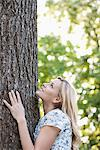 Woman hugging tree outdoors Stock Photo - Premium Royalty-Freenull, Code: 635-05550257