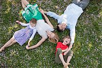 Family laying in grass together Stock Photo - Premium Royalty-Freenull, Code: 635-05550261