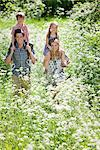 Parents carrying their children piggyback outdoors Stock Photo - Premium Royalty-Freenull, Code: 635-05550266