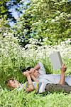 Father and son relaxing in grass Stock Photo - Premium Royalty-Free, Artist: AlaskaStock, Code: 635-05550271