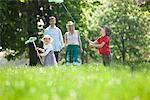 Family playing in park Stock Photo - Premium Royalty-Freenull, Code: 635-05550278